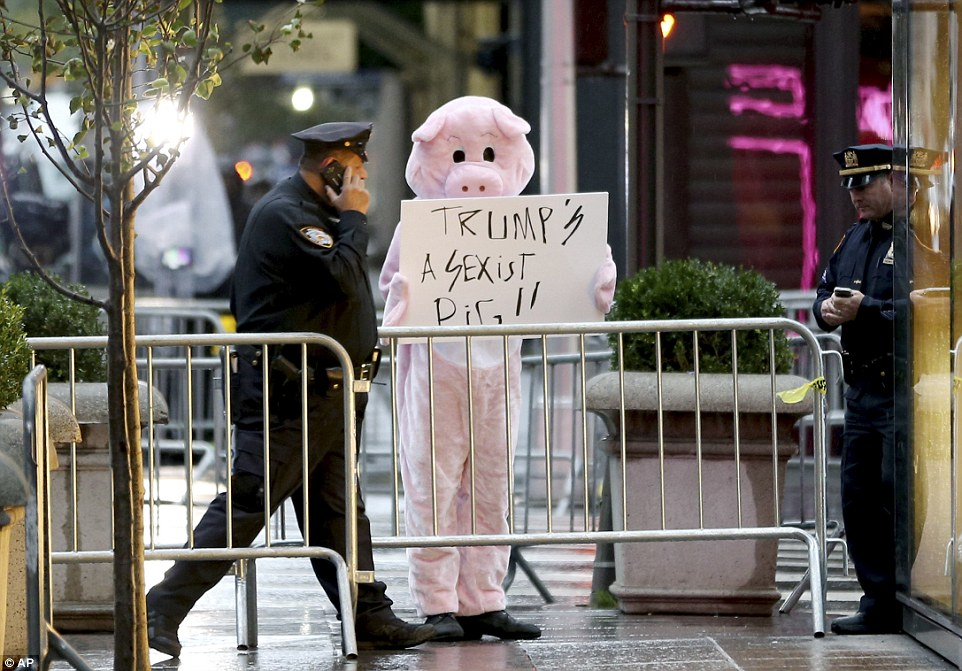 Despite the harsh rain and cold weather, one protester donned a pig costume to protest outside Trump tower
