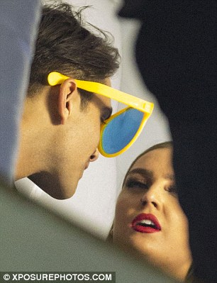 Funny man: Luke showed his light-hearted side at the bash as he donned a set of huge yellow glasses for the snaps