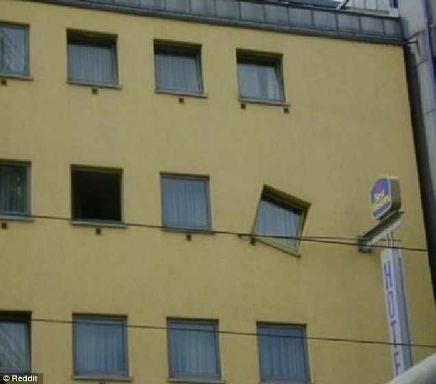 A window in the Best Western Hotel appears to have been angled to the right, instead up running straight up and down like every other equally spaced, glass panel on the building