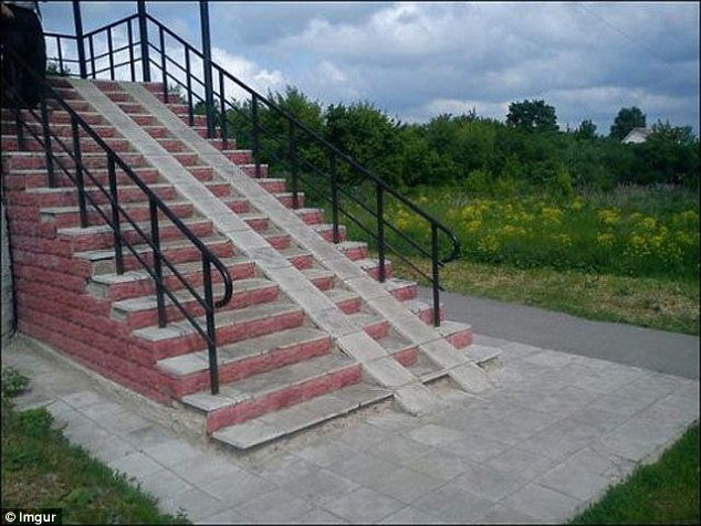 A large set of stairs has two mystery ramps - with no accessible handrails - in the middle