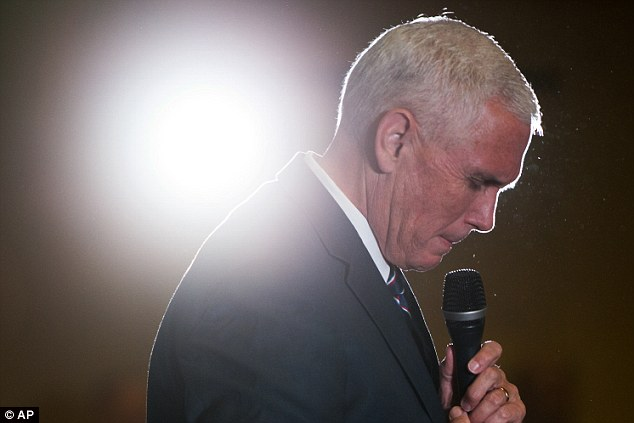 Pence (above on Thursday) pulled out of an appearance on his running mate's behalf in Wisconsin on Friday after the tape was released
