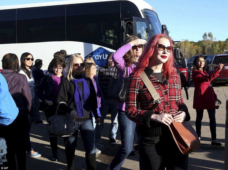 A peek inside: Some of the first Paisley Park tour ticket holders disembark a the bus for the new Paisley Park Tour on Thursday
