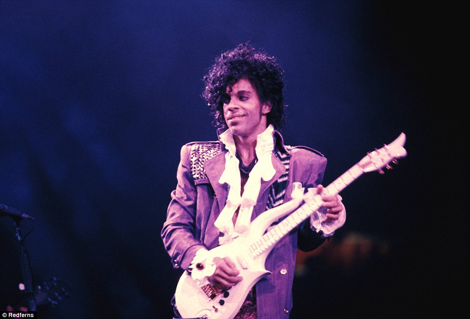 Remembered: Prince is pictured wearing his signature color purple in this file photograph