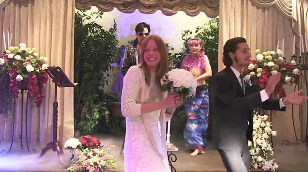 Mr and Mrs: TheLaBeoufs smile happily as they walk into the chapel