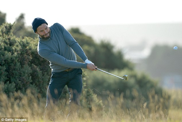 King of swing: Jamie Dornan, 34, continued his good golfing form on Saturday as he swung his way around the iconic St Andrew's Old Course as part of the Alfred Dunhill Links Championship