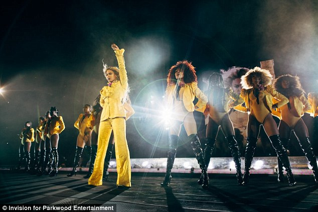 Favourite colour? Queen B looked quite comfortable onstage for another number, opting for a bright yellow pantsuit