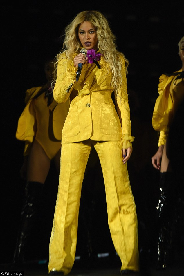 Quite conservative: The 35-year-old songstress's decidedly non-skimpy outfit consisted of a fit blazer with a ruffled lining, and a well-creased matching set of trousers