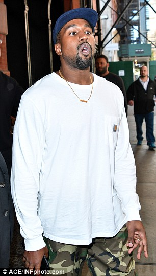 New world: kanye wore a Saint necklace as he headed to his car, while fans watched