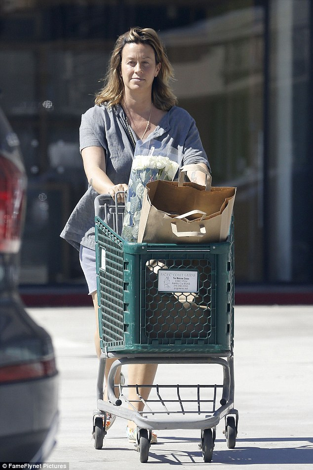 Laid-back look: The Canadian beauty dressed down and went without make-up as she was spotted grabbing some groceries along with some fresh flowers