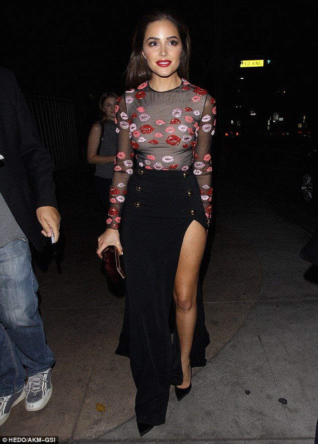 Evening attire: The beauty displayed her tanned, toned legs in a two piece ensemble