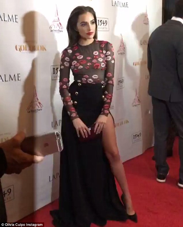 Red carpet wonder: In a video clip, Olivia gave her best poses for multiple flashing cameras