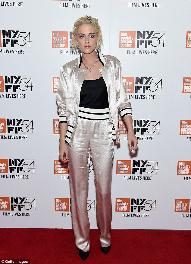 Suits you! Kristen Stewart wore a white satin track suit complete with black blouse for a Q&A of her new film Personal Shopper at the New York Film Festival