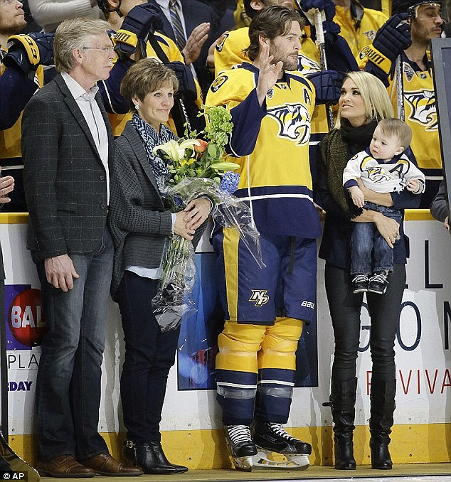 Her two guys! Carrie pictured here with husband Mike Fisher and son Isaiah