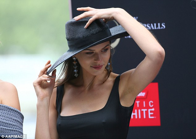 Feeling nippy? Harry Styles' ex Georgia Fowler went braless in a skintight black top as she attended Spring Champion Stakes Day at Sydney's Royal Randwick on Saturday