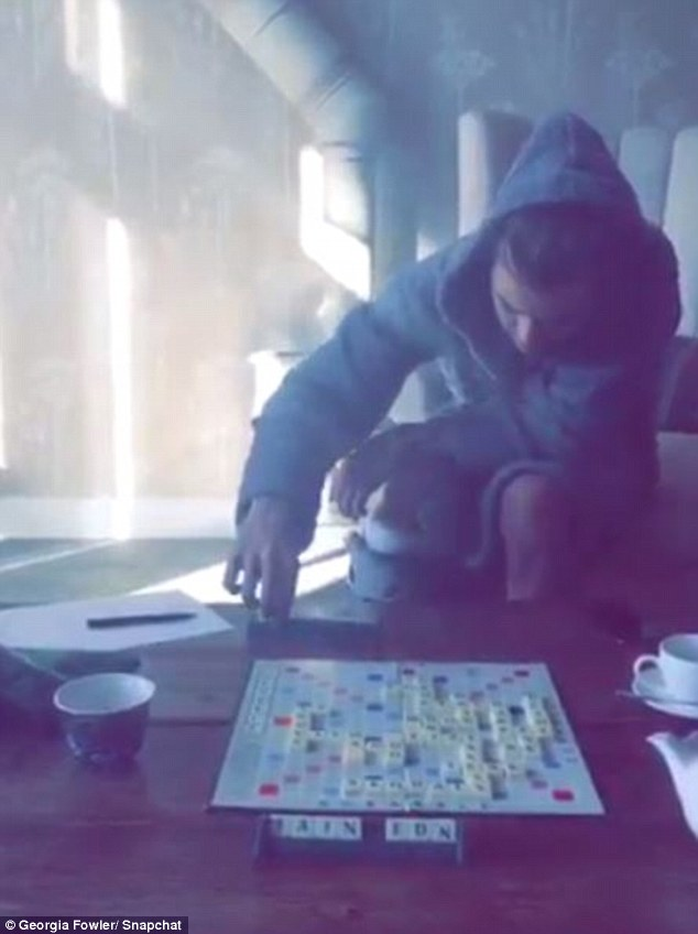 All fun and games? Georgia had shared a Snapchat video of the One Direction singer, 22, playing Scrabble in what appeared to be her home