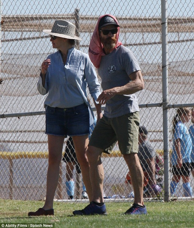 Dressed for the heat: The Oscar winning actress and her husband of 14 years, Danny Moder, stayed cool on the sidelines while their children played