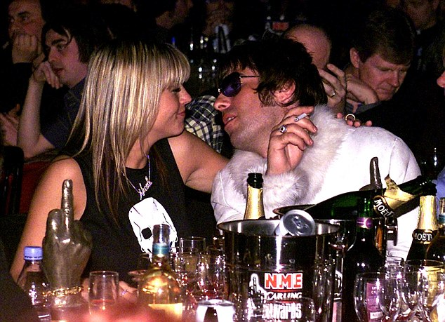 Boozy past: Liam drinks and smokes with his then girlfriend Nicole Appleton at the NME Carling Awards in 2001