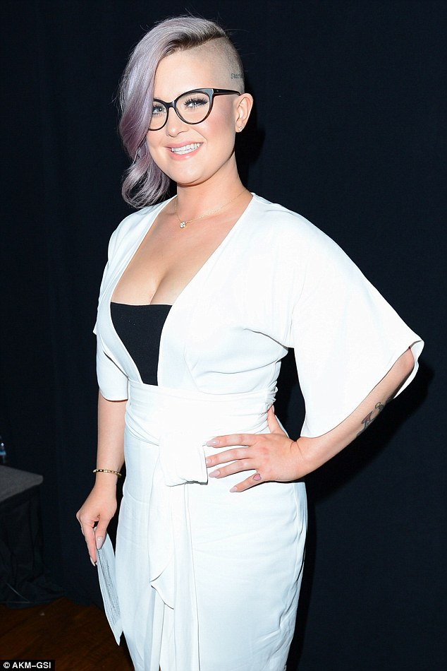 Smart: Kelly still managed to make a bold and smart statement at the event in her monochrome outfit and buzz haircut