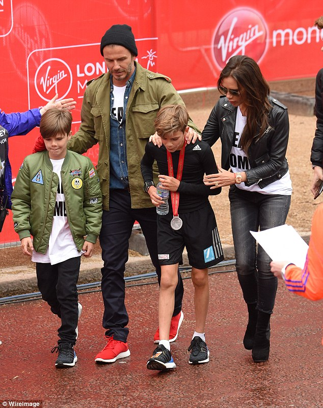 'David and I are very, very present as parents': Victoria and David like to spend their downtime socialising as a family with their four children (Pictured in April 2015 with Cruz left and Romeo right)