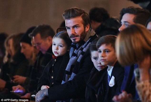 Doting father: David is often seen with the couple's children front row at her shows