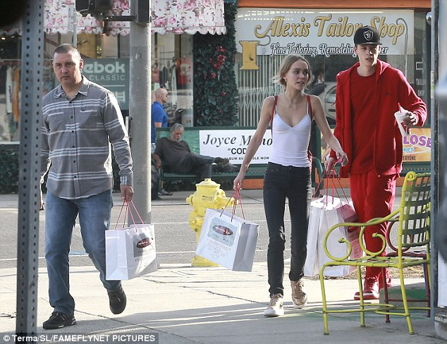 Re-shod: They both carried bags from the Melrose Avenue shoe shop Sportie LA