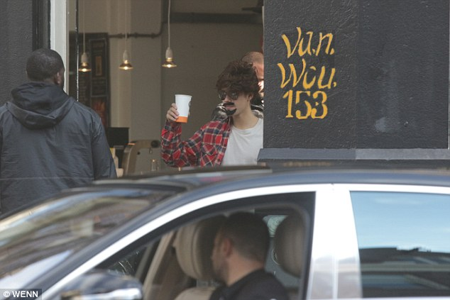 Raising a toast: He even toasted fellow coffee shop goers in the street