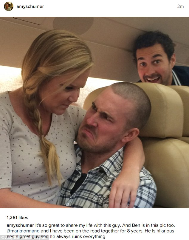 World tour: Amy Schumer took to Instagram on Sunday to document life on the road with her boyfriend Ben Hanisch, as her comedian pal Mark Normand photo bombed them