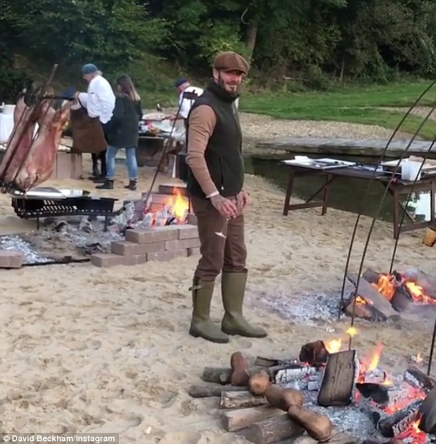 Stylish: Looking every inch the country bumpkin in his wellies, cords, zip up vest and flat cap, David steps into the middle of the elaborate - and boiling hot - campfire