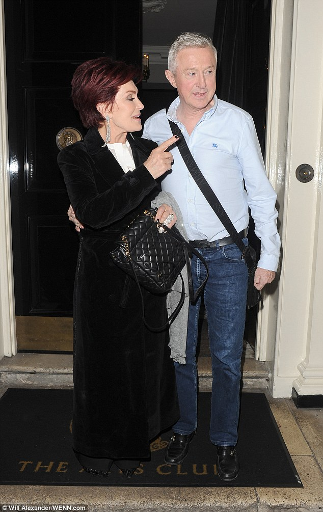Whispers: Sharon looked chic in a ground grazing black trench which she layered over a white blouse and black wide leg trousers