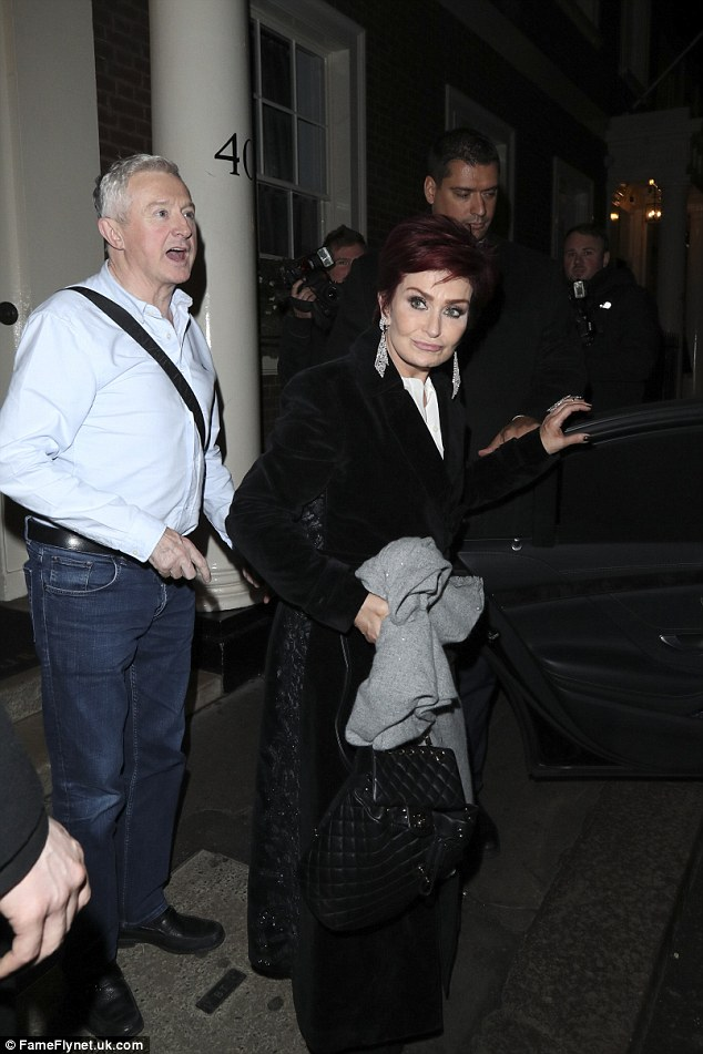Gentleman: Louis accompanied Sharon to her car as they left the venue