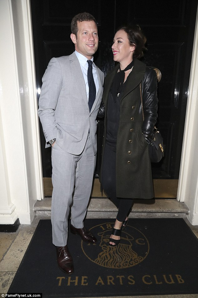 Dapper: The X Factor presenter looked suave in his grey suit alongside his TV producer love