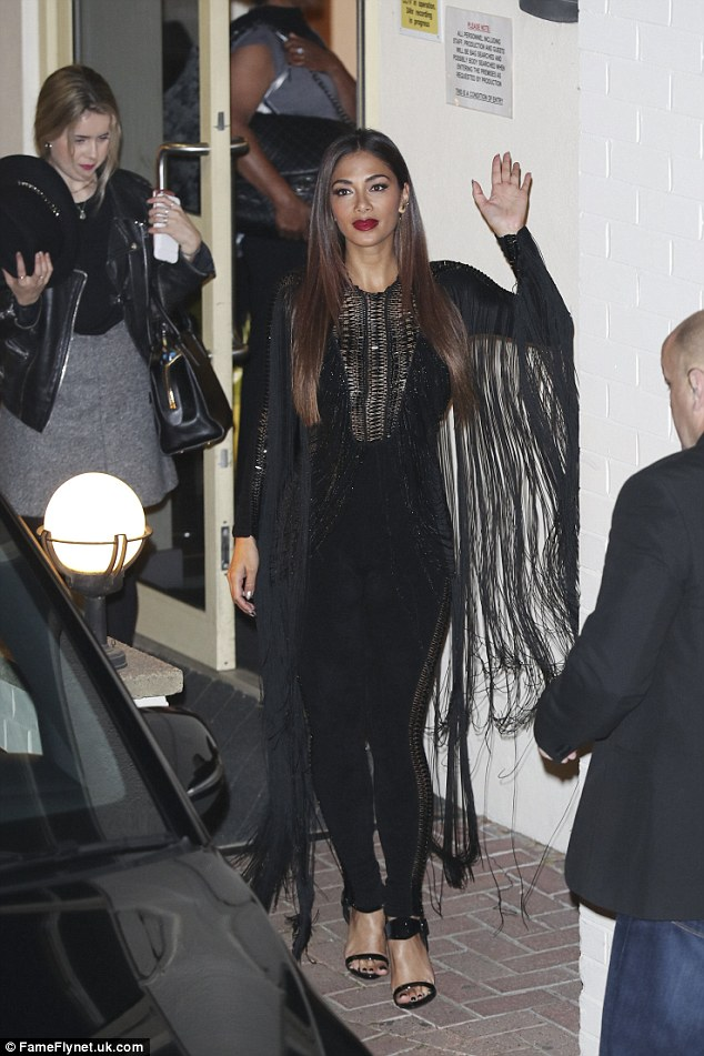 Making her exit: Nicole Scherzinger looked incredible in her slinky black jumpsuit as she left the X Factor studios on Sunday night after the first results show