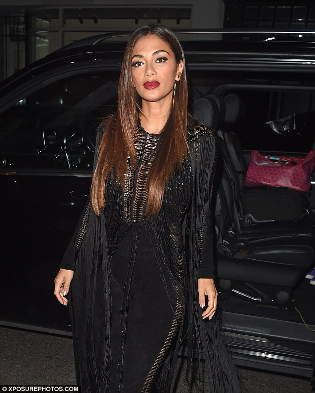 Party time:The former Pussycat Doll's cat suit showed off her sensational figure to perfection as she headed to Sharon Osbourne's birthday dinner