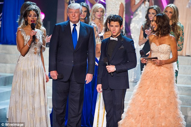 "'I'm allowed to go in, because I'm the owner of the pageant and therefore I'm inspecting it…. ""Is everyone OK""? You know, they're standing there with no clothes,' Trump (pictured at the 2013 Miss USA pageant) said"