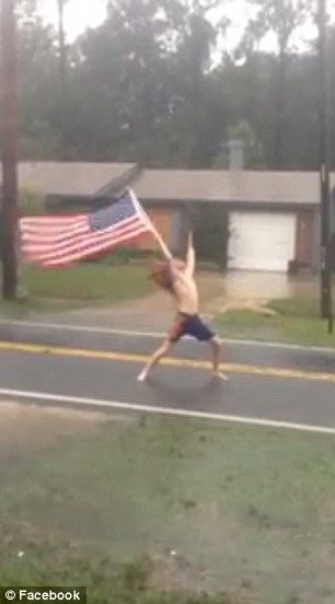 The topless man rocked out to heavy metal music as he braved strong winds and rain during Hurricane Matthew