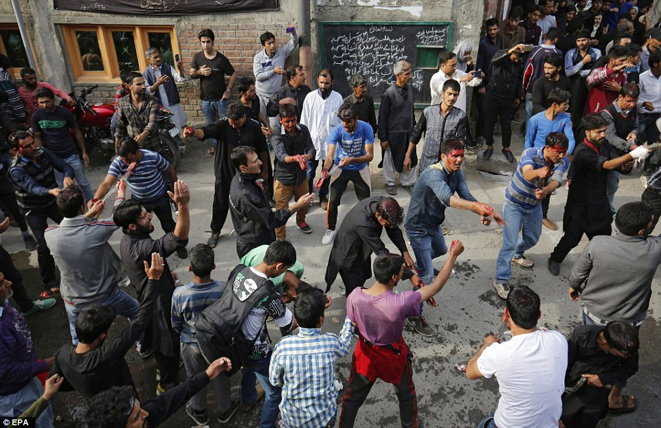 Kashmiri Shia Muslims flagellate themselves as they take part in a religious procession held on the seventh day of Islamic month of Muharram, in Srinagar