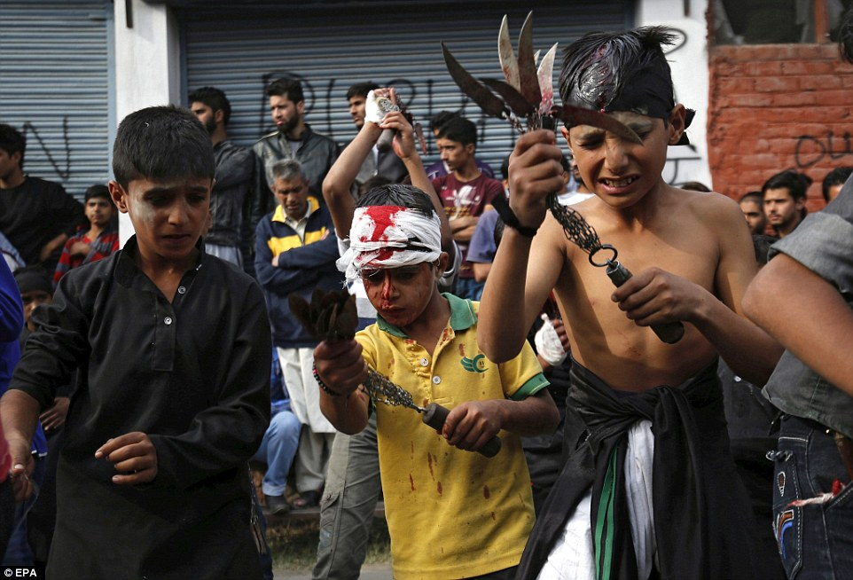 Kashmiri Shia Muslim children flagellate themselves as they mourn the death of Imam Husain, the grandson of Prophet Muhammad