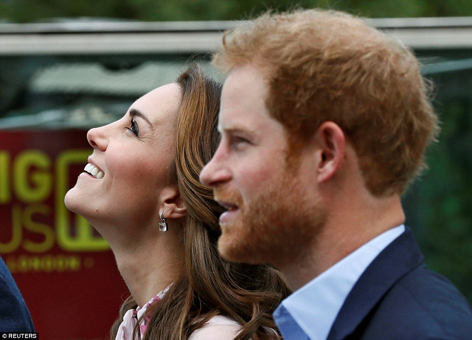 Kate glances upwards as she strolls along with Prince Harry. Later the trio will board the London Eye with people who have shared their experiences of mental health issues