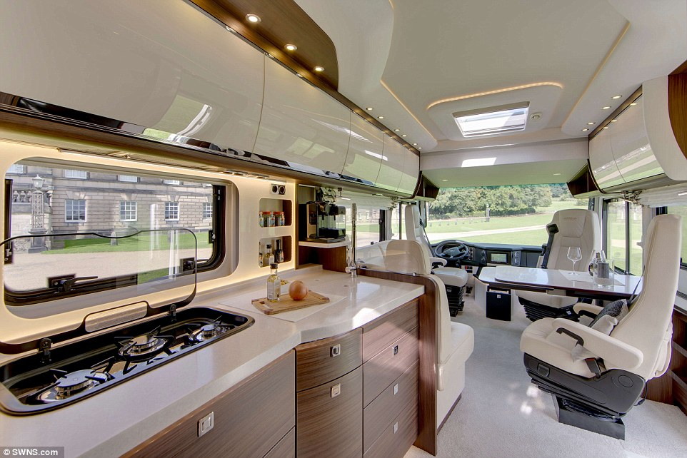 State-of-the-art: The35ft long Morelo Empire Liner comes with a fully-equipped kitchen, perfect for whipping up feasts on a 'staycation'. The interior of the motorhome also offers the driver and passengers plenty of light and space