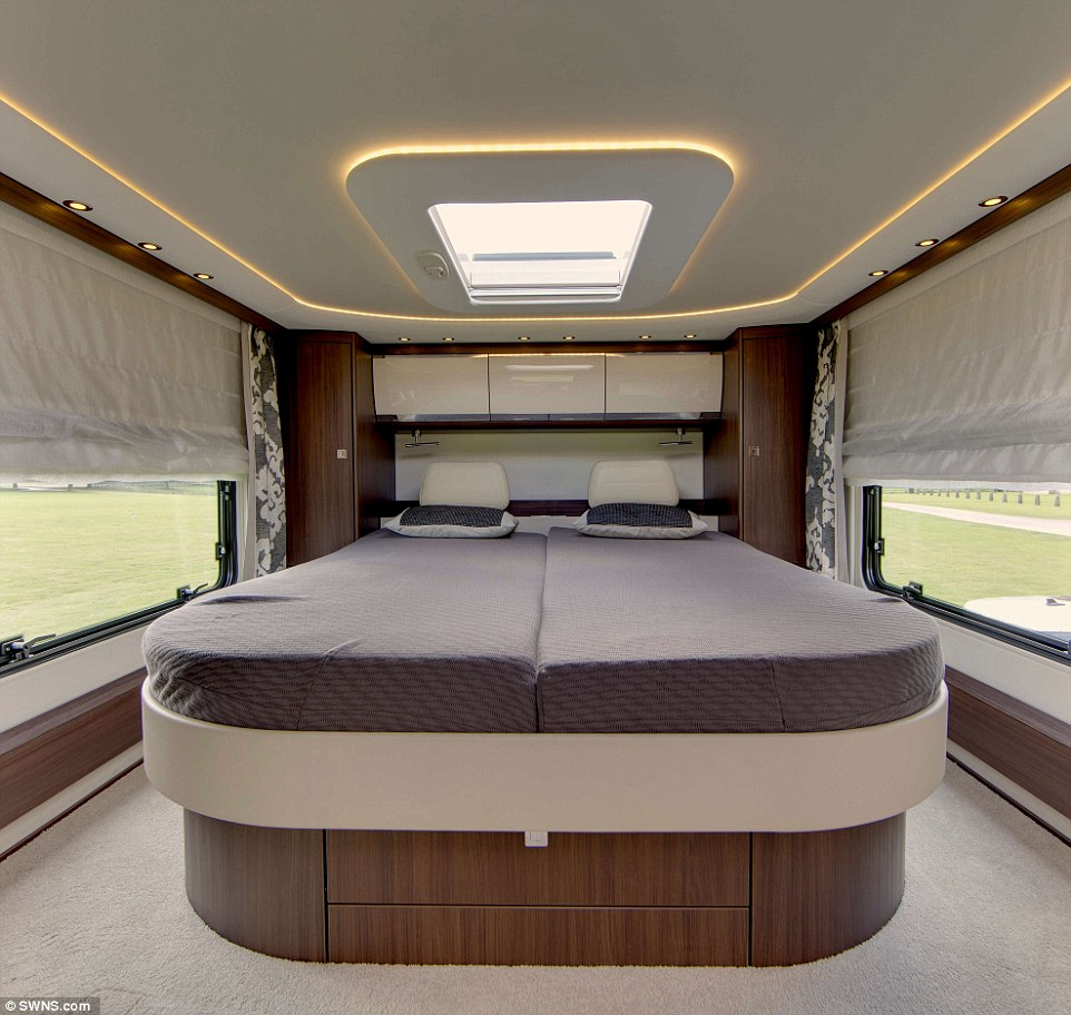 Ultimate luxury: A stunning skylight in the bedroom means the owner can enjoy evenings looking up at the night sky while drifting off to sleep, pictured. The sleeping quarters also boast subtle lighting which adds to the relaxing mood