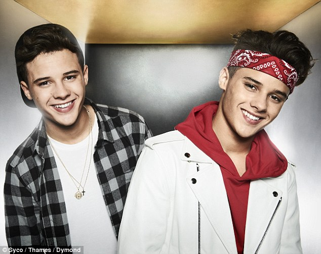 Suspended: Josh (left) and Kyle (right), aka Brooks Way, were dropped from Saturday night's X Factor live show following claims Josh broke ex girlfriend Amelia Clarke's nose - and he was also accused of beating up his brother regularly