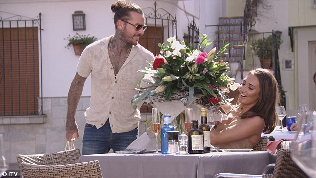Happier times: The new TOWIE episode, which aired on Sunday, saw Pete, 26, declare his love for his girlfriend Megan, 24, on her birthday - just days before his unfaithful behaviour was discovered