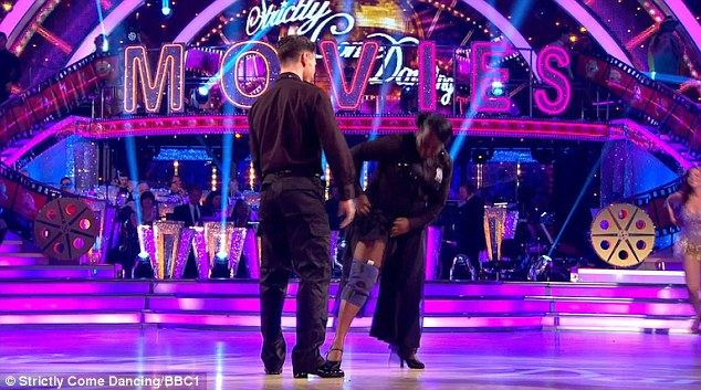 I'll show them: Tameka said she wouldn't let her back injury stop her before heading to the floor, only to lose the judges vote before doing a final defiant lap with her leg brace on show
