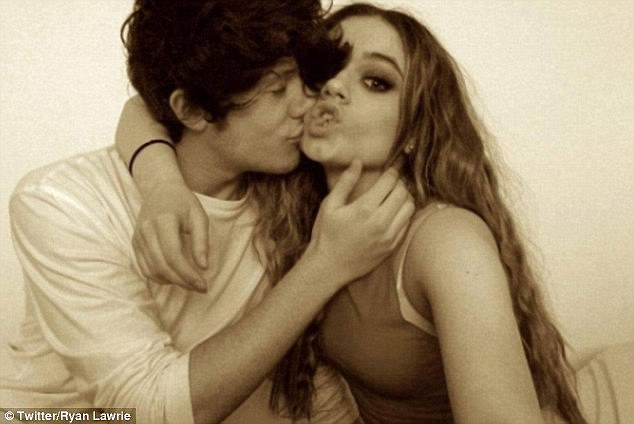 Getting closer: Emily Middlemas and Ryan Lawrie have been accused of 'getting frisky' inside the X Factor mansion, despite a sex ban