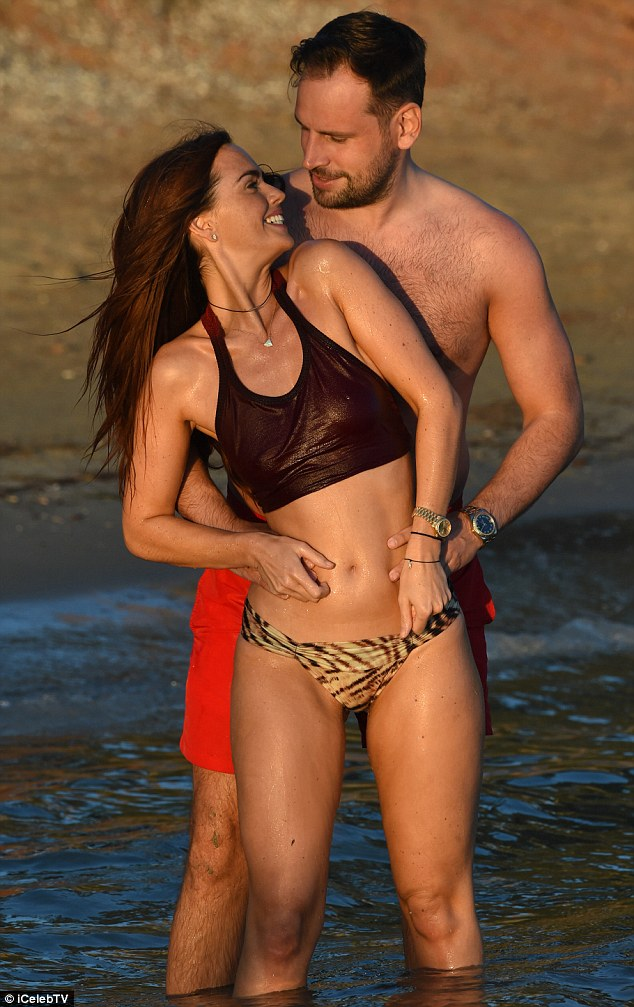 Flirty display: Jennifer Metcalfe, 34, and boyfriend Greg Lake , 31 - who have been dating since 2013 - packed on the PDA as they frolicked in the water