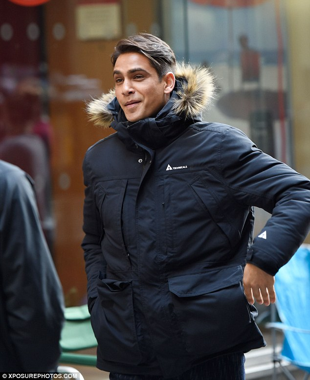 Reason to smile: Luke Pasqualino, 26, couldn't wipe the smirk off his face as he continued filming his upcoming TV drama Snatch in Manchester on Monday morning