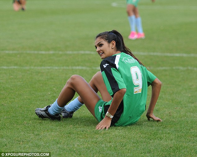 Grounded: She also enjoyed a quick stretch on the ground ahead of the anticipated match