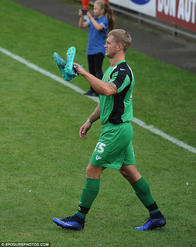 He's got plenty of sole: At one point, he was seen walking the pitch with an extra set of boots