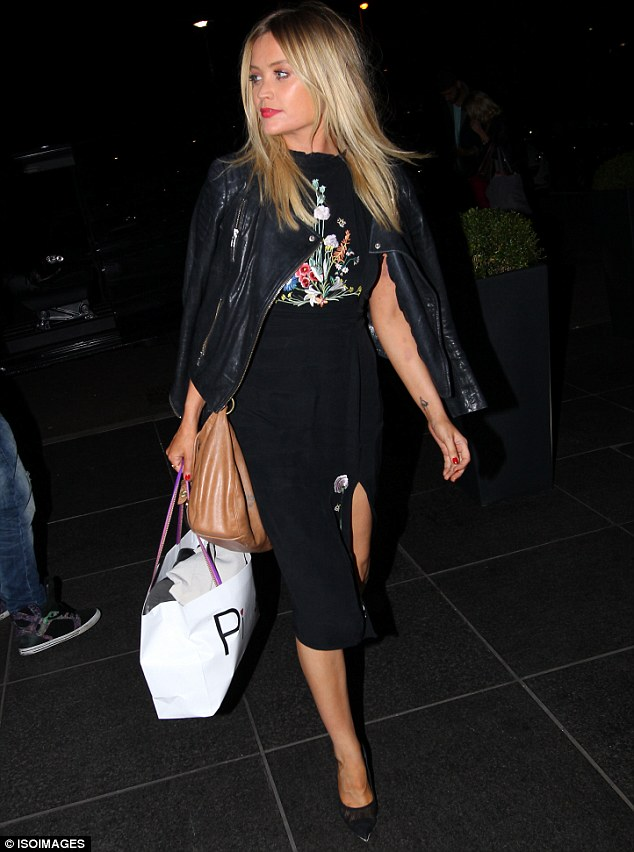 Leading the charge: Laura Whitmore opted for a more demure look as she arrived back at her hotel following Saturday night's Strictly Come Dancing
