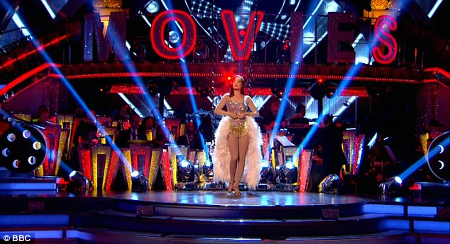 Latin queen: The stunner appearance comes after she flaunted her slender figure in a sparkly showgirl dress adorned with feathers at the back as she descended from the ceiling into her Moulin Rouge Salsa